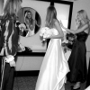 Bride adjusts her hair in the Mirror, going for the First Look