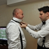 Groom puts Bowtie on the Father of Bride - Getting Ready