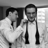 Groom lines up Groomsman's Bowtie - Getting Ready Millenium Times Square