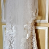 Wedding Dress and Veil Hang on Yellow Door
