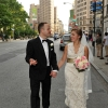 Groom Talking to Bride as they Walk up 5th Avenue in Front of Flat Iron Building