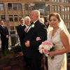 Bride Reaches Front of Aisle during Processional of Rooftop Wedding ML&T