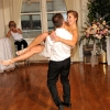 Groom carries and spins around with Bride during First Dance