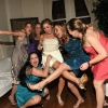 Bride and Friends Pose for Fun Photo, legs kicking