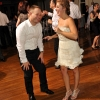 Groom Laughing with Bride on Dance Floor