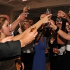 Bride and Groom raise Shot Glasses with Guests