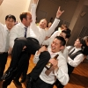 Groom Lifted into the Air by Friends